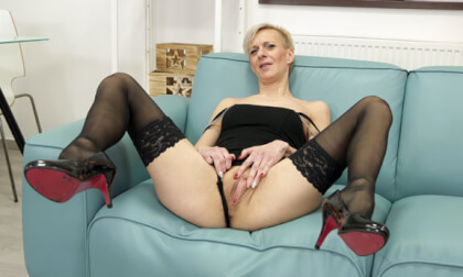 Lady Belinda Solo on the Couch; solo striptease mature GILF MILF blonde heels nylons toys masturbation