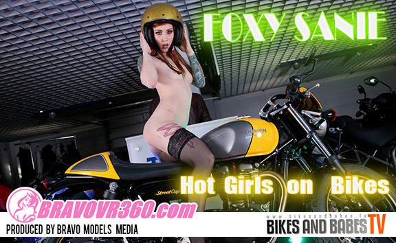Sexy Redhead Foxy Saine is Ready to Ride - Biker Babe Tattoos Model