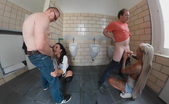 Three Amateur Babes Suck and Fuck Five Cocks in a Public Toilet - Bathroom Orgy with Blowjobs
