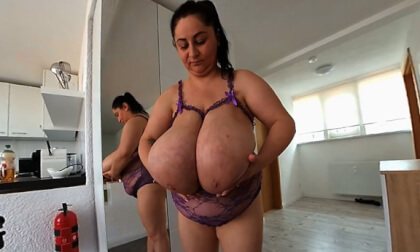Alice in the Mirror; BBW brunette with huge tits stripping